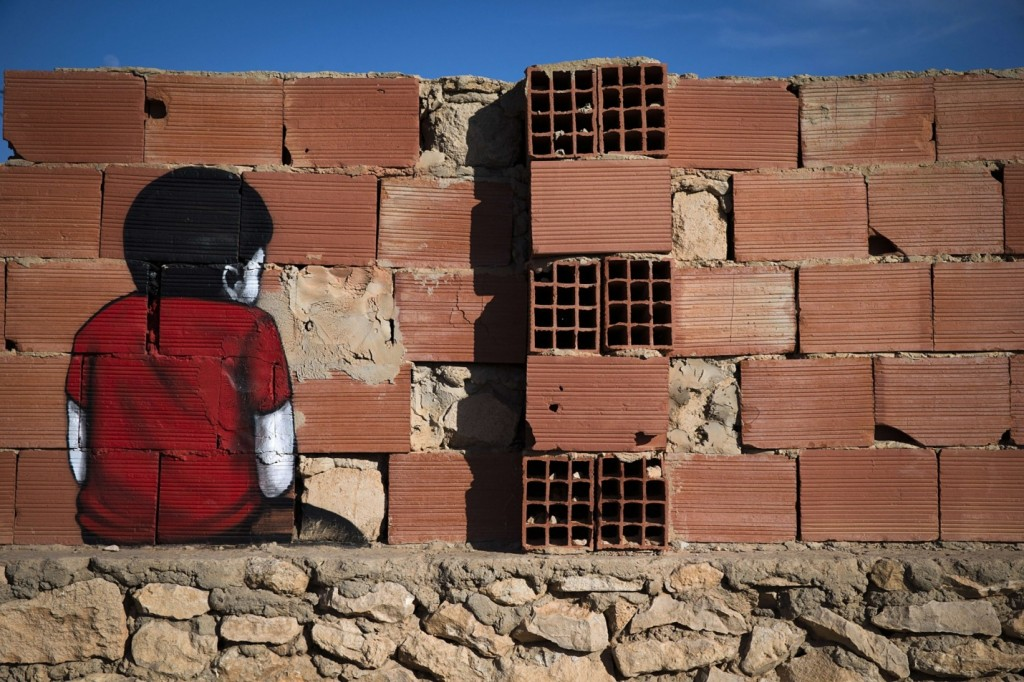 A mural by Brazilian artist Tinho decorates a wall. The village of Erriadh is one of the oldest in Tunisia, where Jews, Muslims and Christians have lived together for centuries. Photograph: Joel Saget/AFP/Getty Images