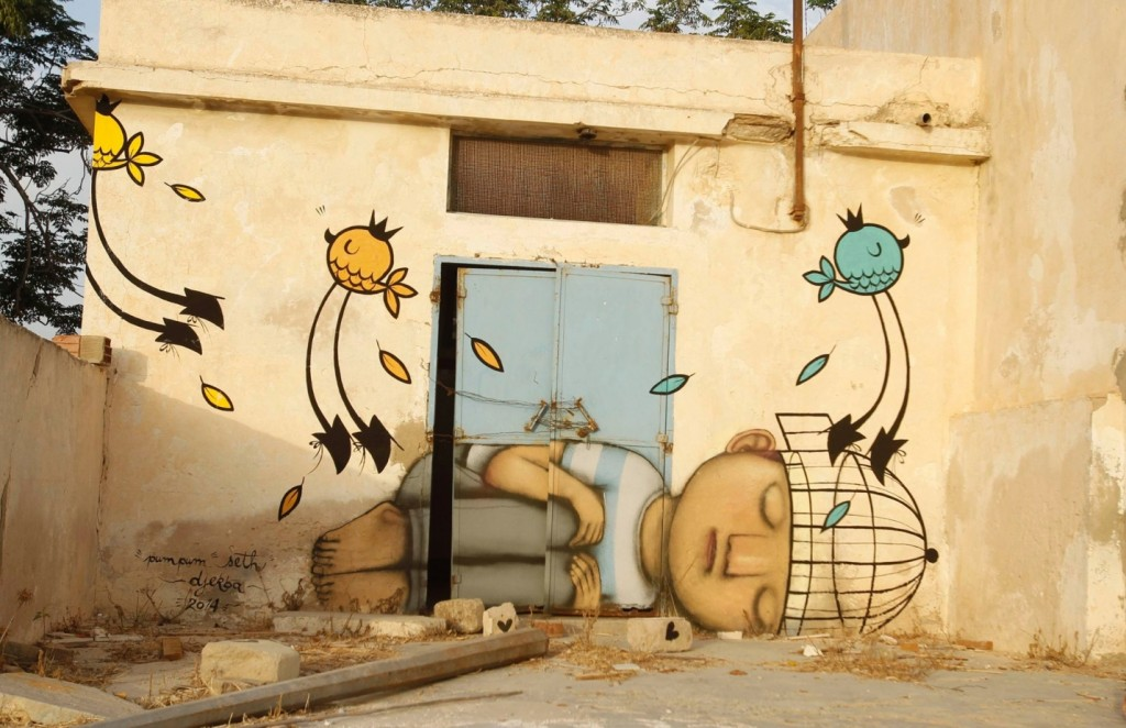 A mural painted by French artist Seth is pictured in Erriadh. Photograph: Zoubeir Souissi/Reuters