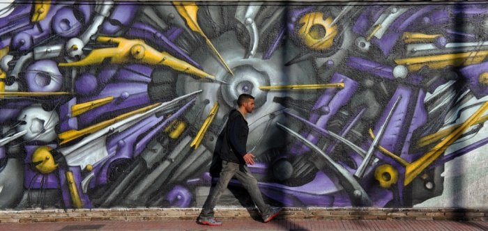 See no evil? While some are bright and jaunty, many of the street artworks in the Greek capital allude to deeper worries