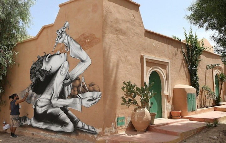razilian artist Claudio Ethos works on his mural. Photograph: Mohamed Messara/EPA