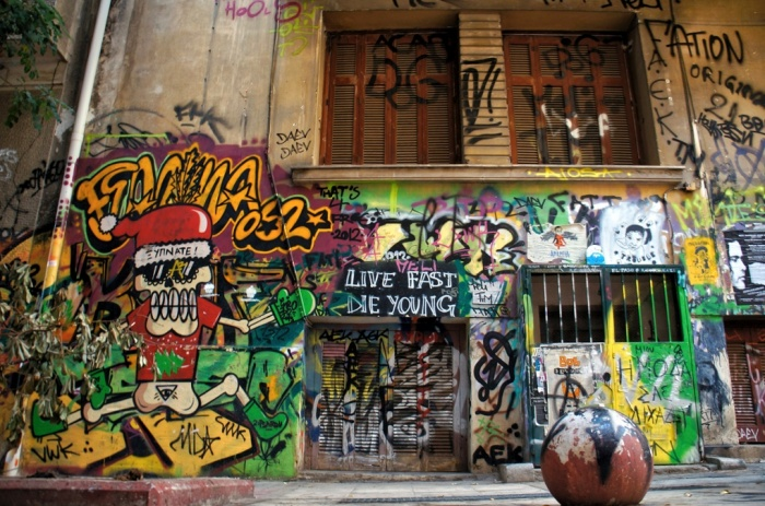 Walls are adorned with works of contemporary graffiti on the streets of Athens