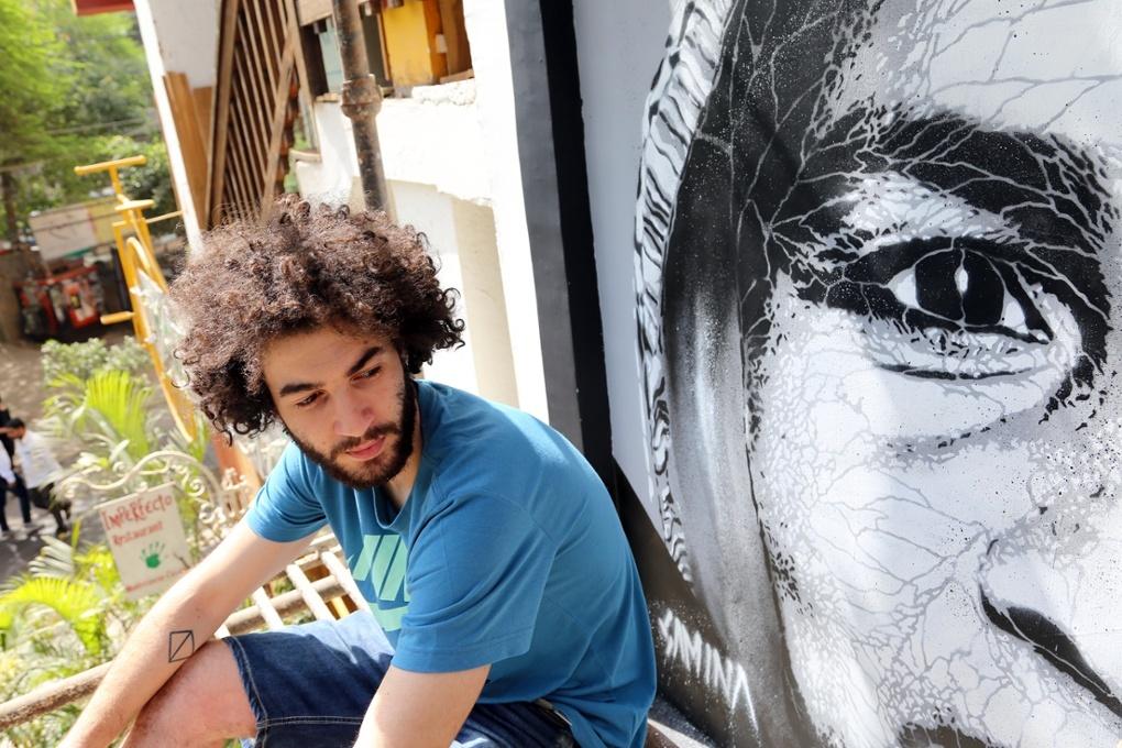 Joao Samina, from Portugal, with his artwork Photograph: Pranav Mehta (By The Guardian)