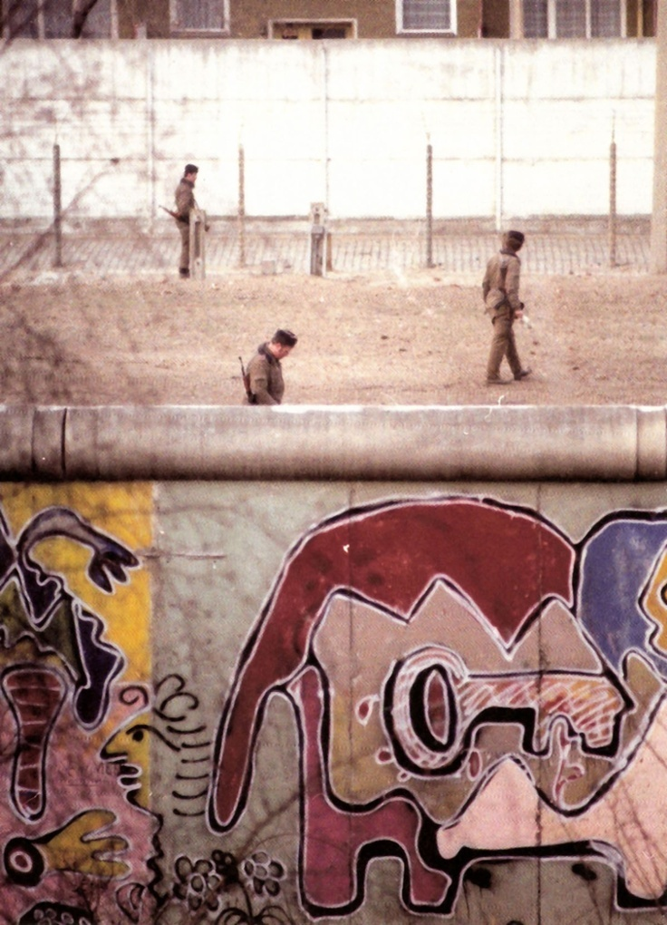A patrol of the Grepos (or border police) of the GDR on the 'death strip' between the two walls, the border of East and West Berlin. I took this from the window of the squat I lived in for 20 years. Nothing really happened at the Berlin Wall. There were no cars, no shops, no noises. I never saw any 'actions' with the Grepos, never saw any soldiers shooting at anybody.