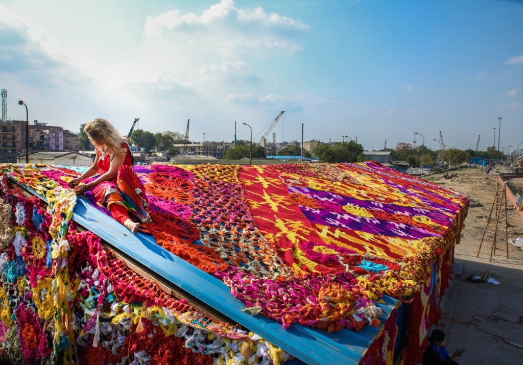 Polish artist Olek enlisted 60 women from different walks of life to help her crochet this blanket on a family night shelter Photograph: Akshat Nauriyal (By The Guardian)