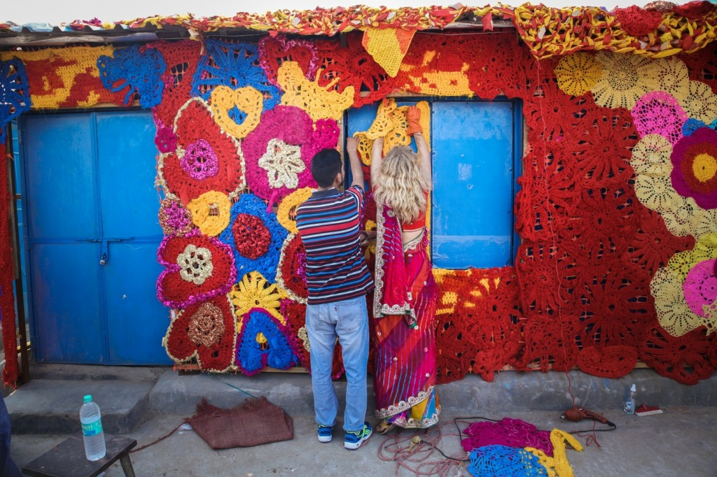 Olek and a colleague work on her gigantic crochet Photograph: Akshat Nauriyal (By The Guardian)