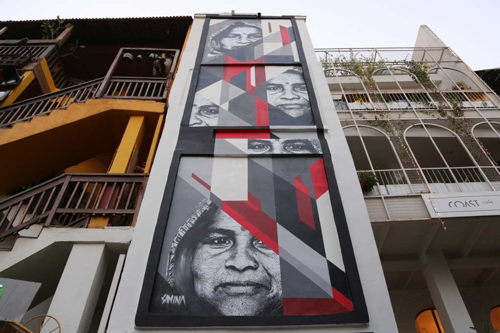 Samina used a stencil technique to depict an anonymous woman on the staircase of a building Photograph: Pranav Mehta (By The Guardian)