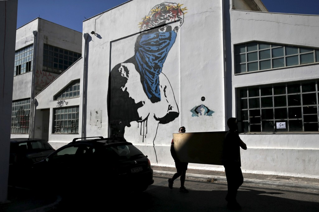 Athena v Europa, Resist v Submit depicts the ancient statue from Milos of the goddess Aphrodite (better known as the Venus de Milo) wearing a scarf and a wreath consisting of the stars of the European Union flag, created by the French street artist Goin Photograph: Alkis Konstantinidis/Reuters