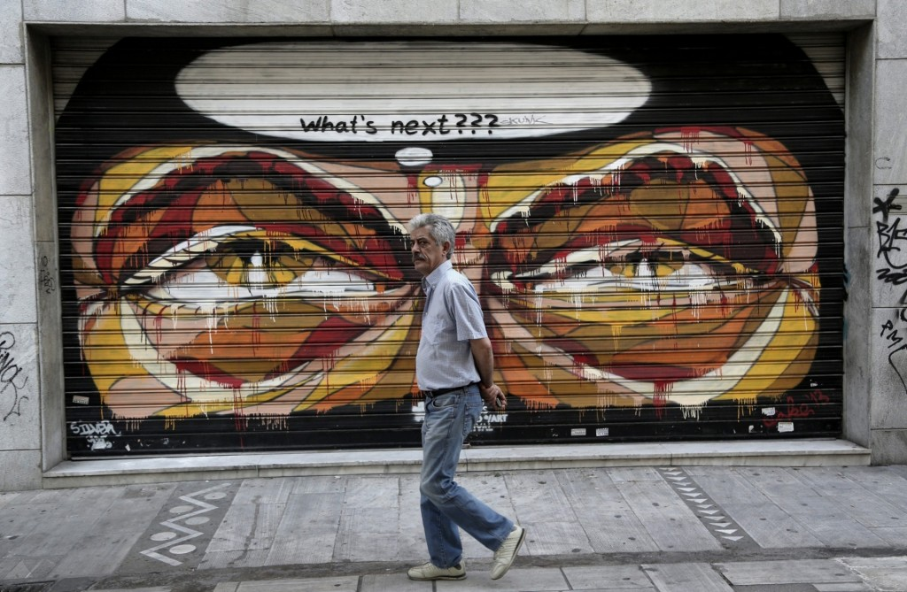 A graffito on a closed shop reflects Greek anxieties about what further EU demands will mean for the country after years of austerity Photograph: Yannis Kolesidis/EPA