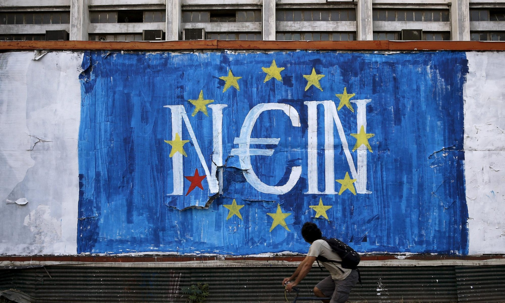 N_Grams' N€IN mural, which has captured Greece's dilemma as it teeters on the brink of withdrawal from the euro. Photograph: Alkis Konstantinidis/Reuters