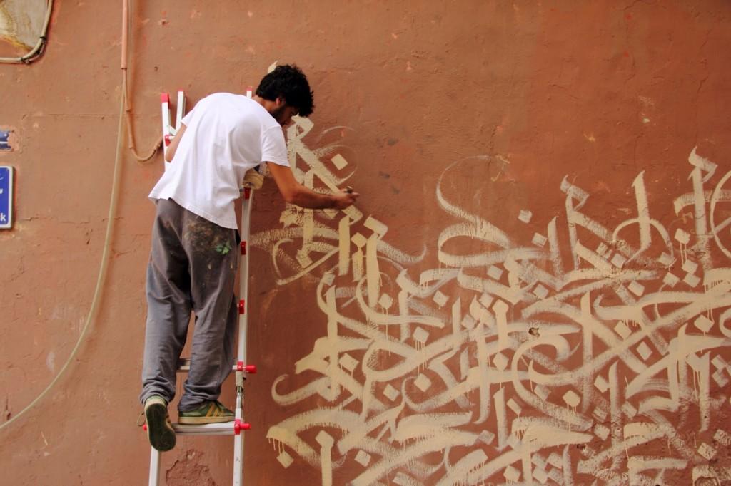 Yazan Halwani in front of the yet-unfinished Fairuz mural in Gemmayze.