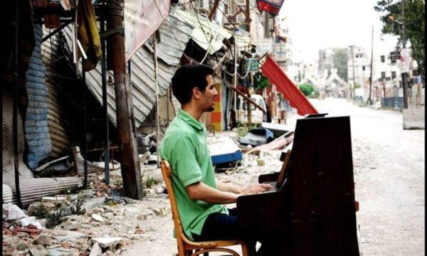 Syria's Piano Man Sings The Stories Of The War