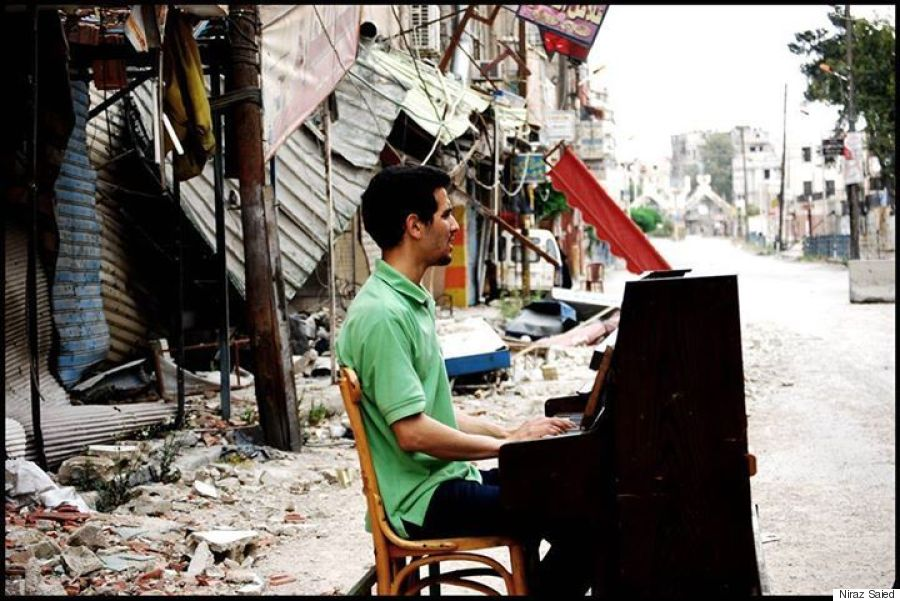 Ayham Ahmad plays in Yarmouk. (Photographer: Niraz Saied)